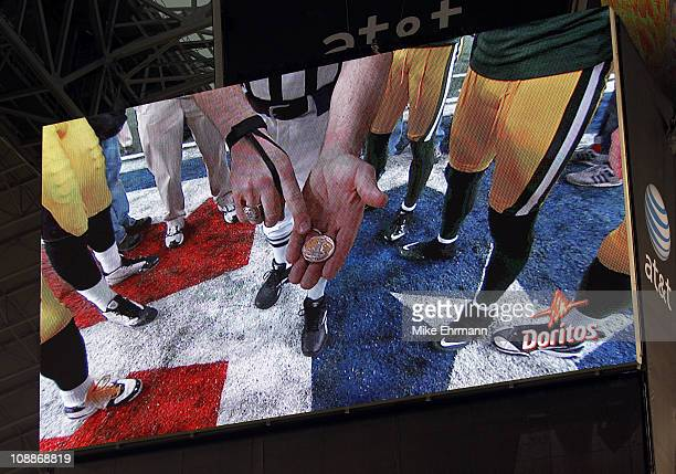 The coin toss is shown on the monitor during Super Bowl XLV at Cowboys Stadium on February 6, 2011 in Arlington, Texas.