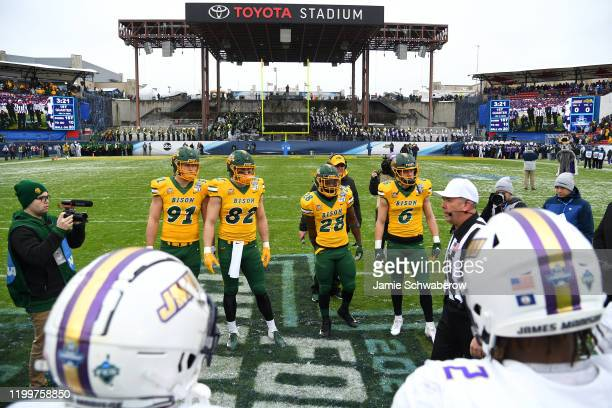 The coin toss takes place between the North Dakota State Bison and the James Madison Dukes during the Division I FCS Football Championship held at...