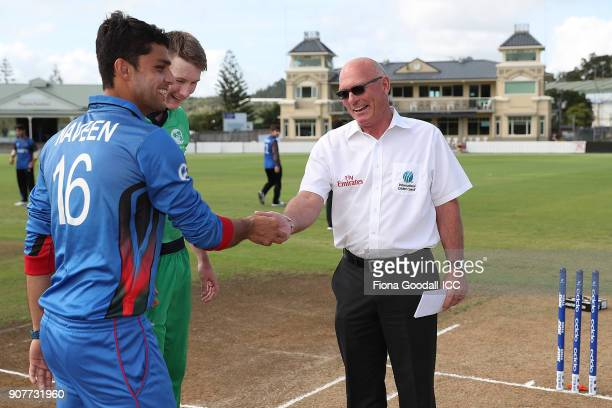 The coin toss with Jeff Crowe and Afganistan captain Naveen Ul Haq and Ireland captain Harry Tector during the ICC U19 Cricket World Cup match...