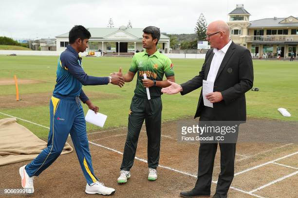 The coin toss with Sri Lanka captain Kamindu Mendis Pakistan captain Hassan Khan and ICC match referee Jeff Crowe during the ICC U19 Cricket World...