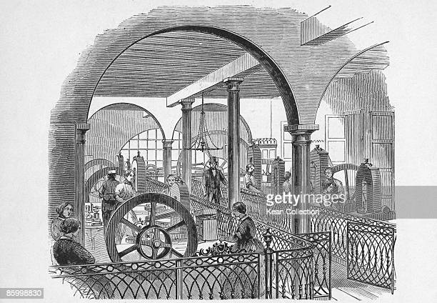 The coining room at the second United States Mint in Philadelphia 1861 A steam engine at the far end of the room powers the eight presses Published...
