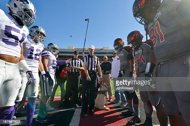 The coins toss between the Texas Tech Red Raiders and the Kansas State Wildcats prior to the Lone Survivor Game hosted by Texas Tech on November 9...