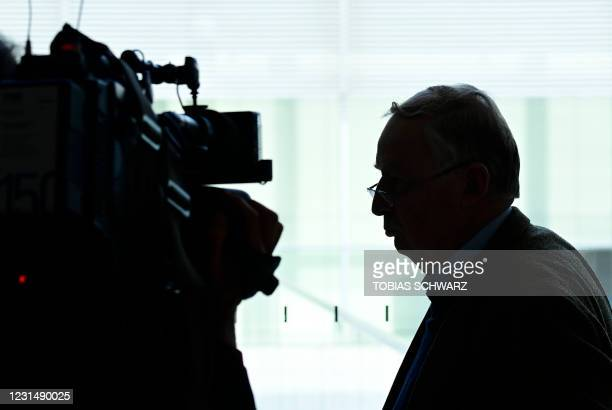 The co-leader of the parliamentary group of the Alternative for Germany far-right party Alexander Gauland is filmed by a cameraman as he leaves after...