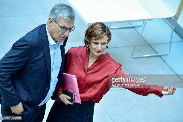 The coleaders of the leftwing Die Linke party Bernd Riexinger and Katja Kipping arrive before giving a statement in Berlin on October 15 on the...