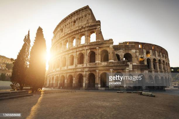 the coliseum icon of rome in a  summer warm dawn: vacations in italy - ancient rome stock pictures, royalty-free photos & images