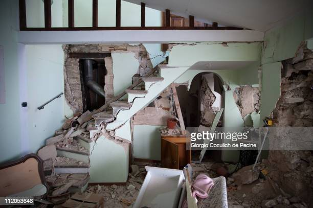The collapsed interior of a house in the historic village of Paganica, two years on from the April 6, 2009 earthquake that struck the Abruzzo region...