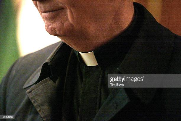 The collar of a priest is seen at St Adalbert Catholic Church March 29 2002 in Chicago IL Good Friday's Way of the Cross services is celebrated by...