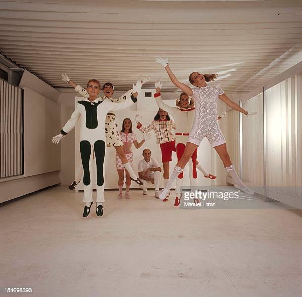 The collection COURREGES 1968 in a salon all white The fashion designer Andre Courreges watches his six models in combination or combinationshort...