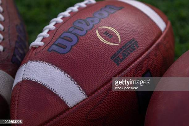 The college football playoff logo on a ball laying on the field before the college football game between the Purdue Boilermakers and Northwestern...
