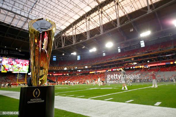 The College Football Playoff National Championship Trophy is seen on the field before the 2016 College Football Playoff National Championship Game...