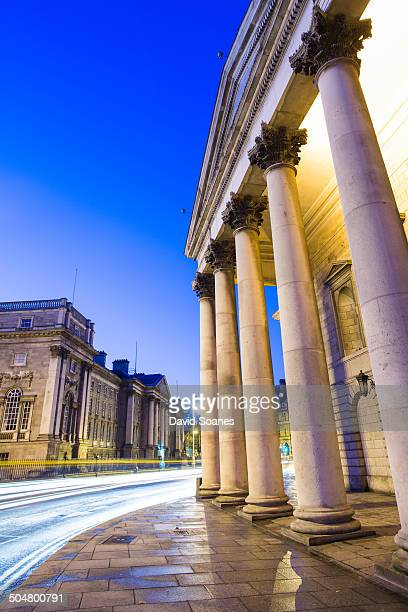 CONTENT] The College Green area of Dublin City at dawn with the former parliament building and Trinity College in the foreground