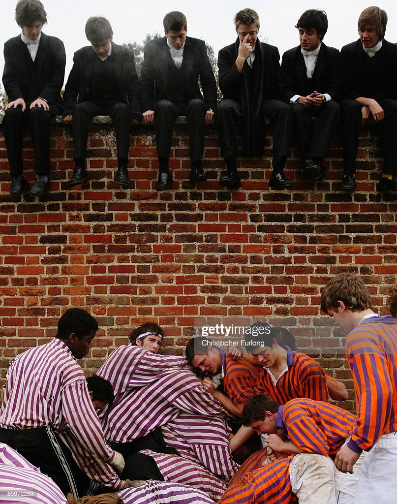 The Collegers and the Oppidians of Eton College take part in the Wall Game, one of the school's oldest traditions, Windsor, England, November 17, 2007. The origins of the game are lost in time but the first recorded game was in 1766 with competition between the two houses is as fierce as ever. The object of the game is to get the ball to either end of the wall and score a goal, which has not happened since 1909. As well as scoring a goal the players can win points with a 'shy' where the ball is held against the wall and touched by the hand and awarded one point.