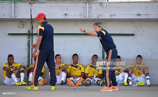 The Colombia team have their half time talk, given by coach Carlos Restrepo, in the shade of the stand during the Toulon Tournament Group B match...