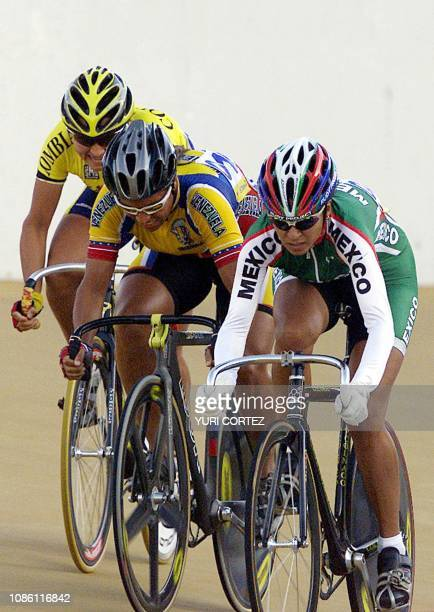 The Colombian Diana Garcia the Venezuelan Daniela Larrea and the Mexican Nancy Contreras compete 29 November 2002 in the madison event of the XIX...