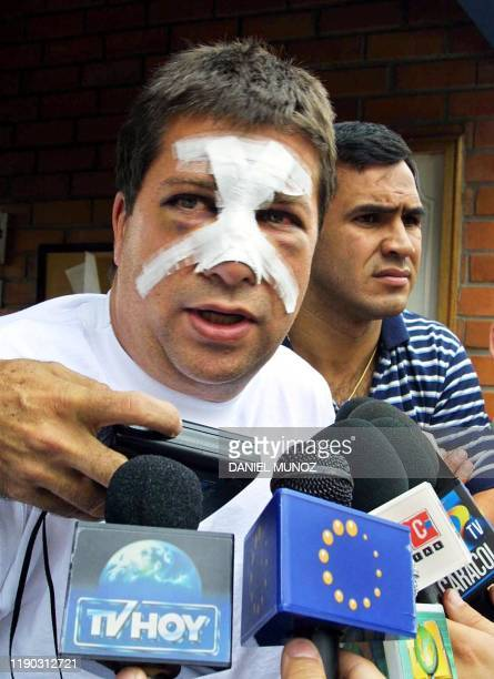 The Colombian Hernan Dario Gomez, head coach of the Ecuadorian soccer team talks to the press, 13 May 2001, as he arrives in Medellin, Colombia. El...