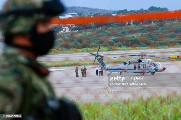 The Colombian presidential helicopter sits at the tarmac of the Camilo Daza International Airport after being hit by gunfire in Cucuta, Colombia on...
