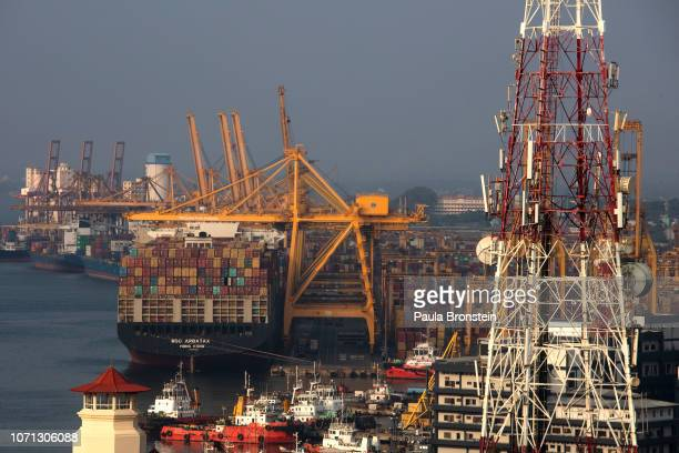 The Colombo deep sea port is seen as container ships move along the ocean on November 13 2018 in Colombo Sri Lanka In just a few years Port City will...