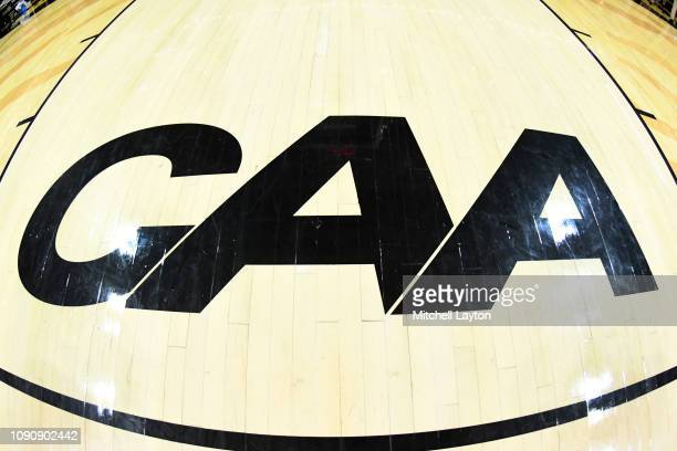 The Colonial Athletic Conference logo on the floor before a college basketball game between the Towson Tigers and the Charleston Cougars at the SECU...