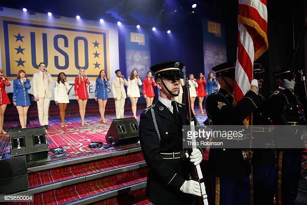 The Color Guard presents flags during the USO 75th Anniversary Armed Forces Gala Gold Medal Dinner at Marriott Marquis Times Square on December 13...