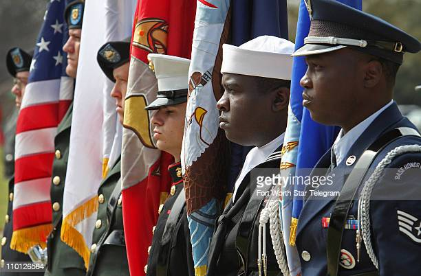 The color guard representing all branches of the United States military stand at attention during a noontime ceremony at Mount Olivet Cemetery in...