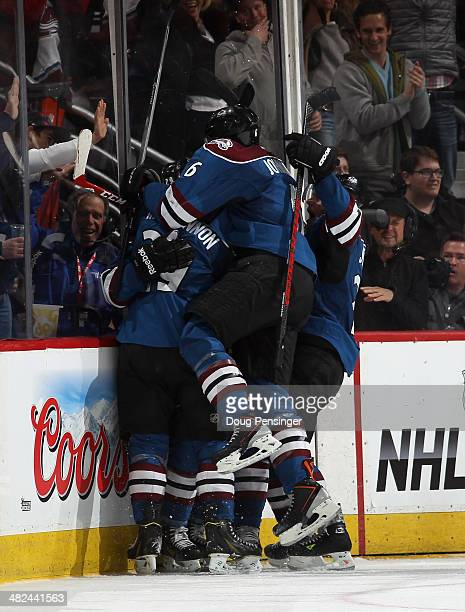 The Colorado Avalanche celebrate a goal by Tyson Barrie of the Colorado Avalanche against the New York Rangers to tie the score 2-2 in the final...