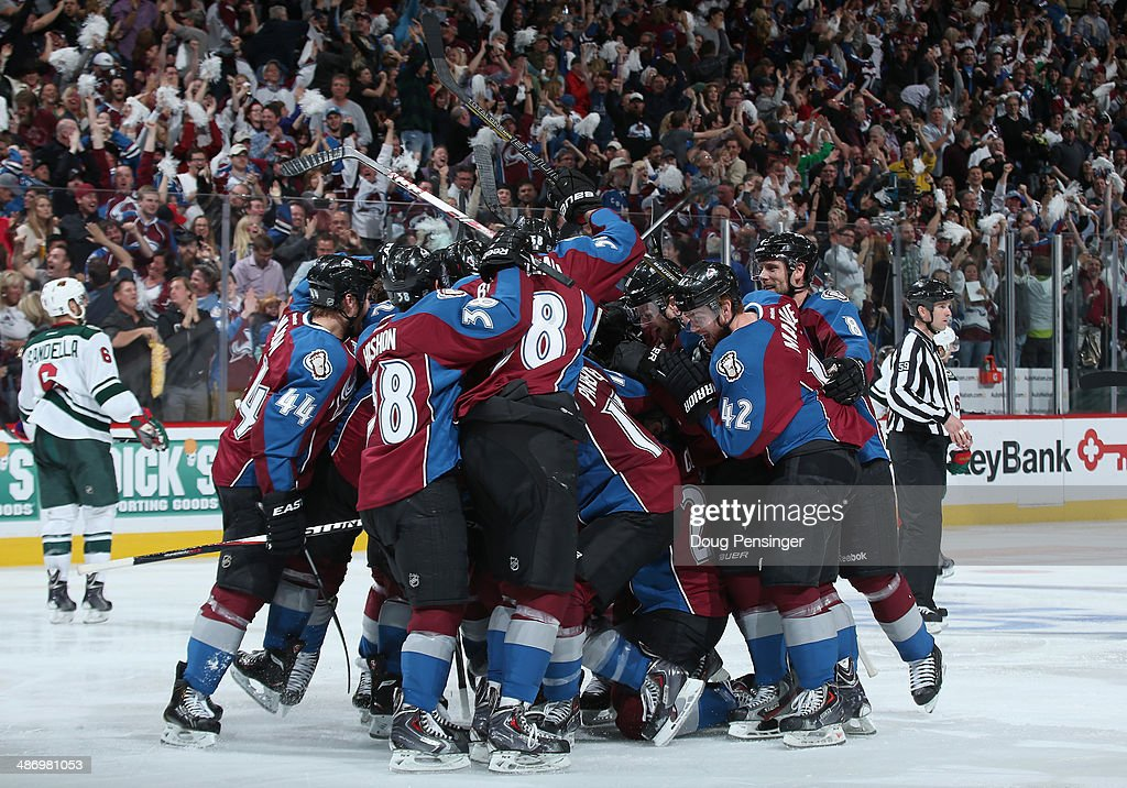 The Colorado Avalanche celebrate the game winning goal in overtime by Nathan MacKinnon #29 of the Colorado Avalanche to defeat the Minnesota Wild 4-3 in Game Five of the First Round of the 2014 NHL Stanley Cup Playoffs at Pepsi Center on April 26, 2014 in Denver, Colorado. The Avalanche hold a 3-2 game lead in the series.