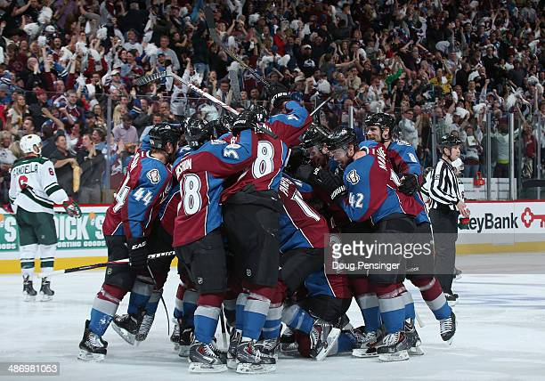 The Colorado Avalanche celebrate the game winning goal in overtime by Nathan MacKinnon of the Colorado Avalanche to defeat the Minnesota Wild 43 in...