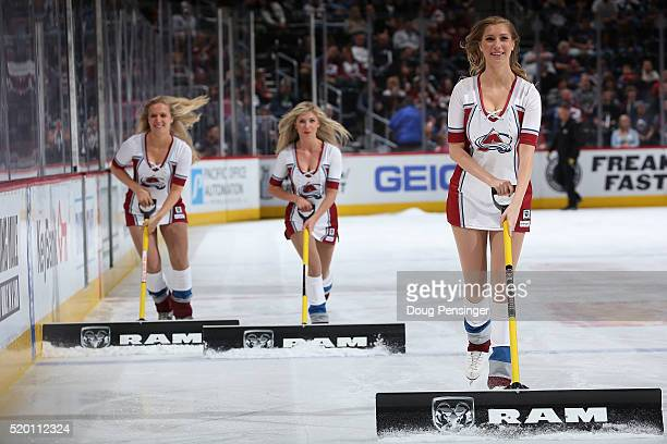 The Colorado Avalanche Ice Girls clean the ice during a break in the action against the Colorado Avalanche at Pepsi Center on April 9 2016 in Denver...