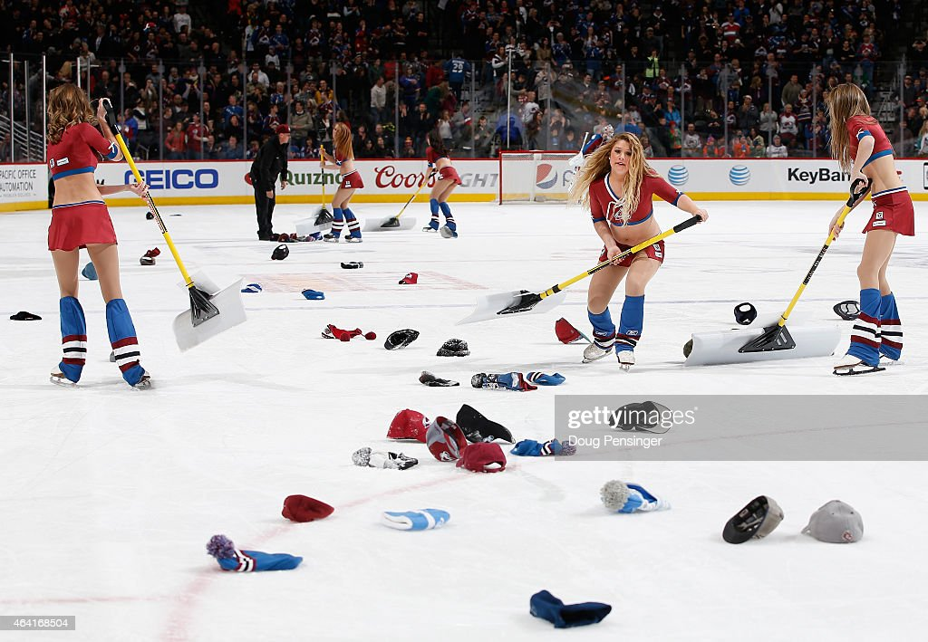 The Colorado Avalanche ice girls clears hats from the ice after Nathan MacKinnon #29 of the Colorado Avalanche scored a hat trick against the Tampa Bay Lightning to give the Avalanche a 4-2 lead in the second period at Pepsi Center on February 22, 2015 in Denver, Colorado.