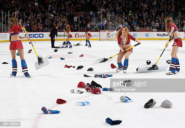The Colorado Avalanche ice girls clears hats from the ice after Nathan MacKinnon of the Colorado Avalanche scored a hat trick against the Tampa Bay...