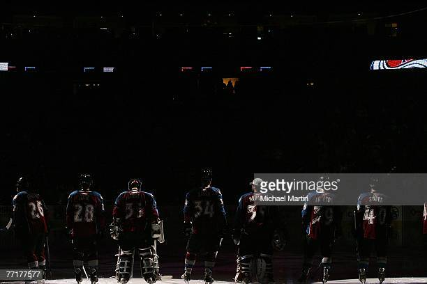 The Colorado Avalanche stand on the ice before their game against the Dallas Stars at the Pepsi Center on October 3, 2007 in Denver, Colorado.