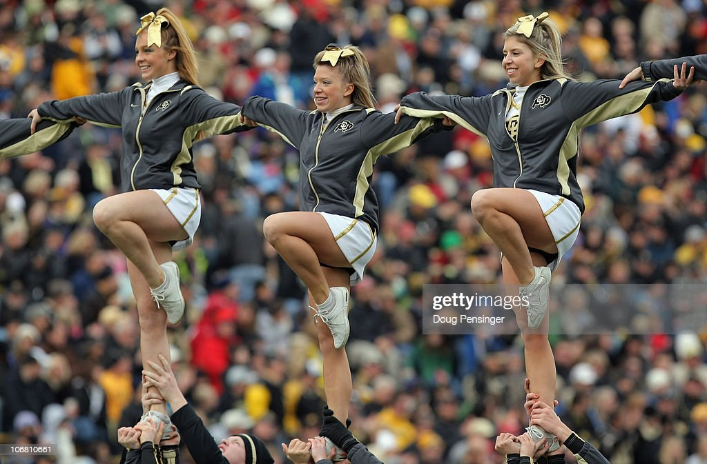 The Colorado Buffaloes cheerleaders perform a stunt during a break in the action against the Iowa State Cyclones at Folsom Field on November 13, 2010 in Boulder, Colorado. Colorado defeated Iowa State 34-14.