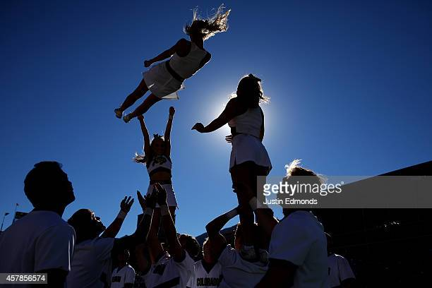 The Colorado Buffaloes cheerleaders perform during a break in the action during a game against the UCLA Bruins at Folsom Field on October 25, 2014 in...