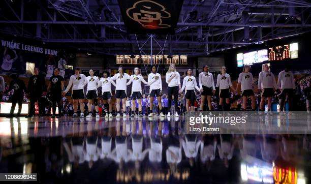 The Colorado Buffaloes line up for the national anthem prior to a game between the Stanford Cardinal and the Colorado Buffaloes at Coors Events...