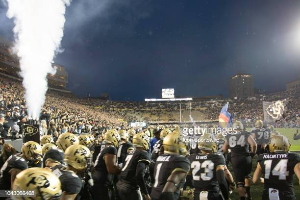 The Colorado Buffaloes take the field during the Colorado vs UCLA football game on September 28 2018 at Folsom Field in Boulder CO