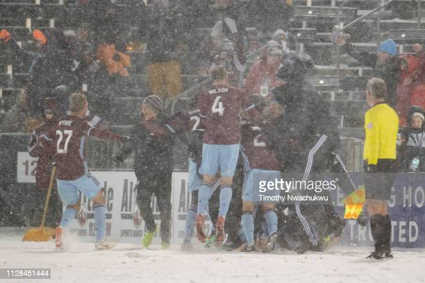 The Colorado Rapids celebrate after equalizing the game during stoppage time against the Portland Timbers at Dick's Sporting Goods Park on March 2,...