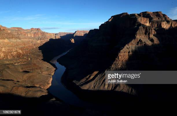 The Colorado River winds its way along the West Rim of the Grand Canyon in the Hualapai Indian Reservation on January 10, 2019 near Peach Springs,...