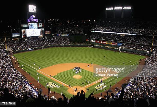The Colorado Rockies celebrate after defeating the Arizona Diamondbacks in Game Four of the National League Championship Series at Coors Field on...
