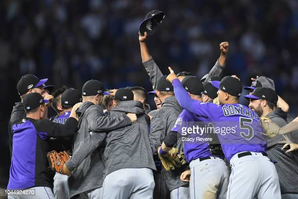 The Colorado Rockies celebrate defeating the Chicago Cubs 21 in thirteen innings to win the National League Wild Card Game at Wrigley Field on...