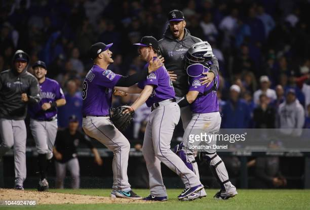 The Colorado Rockies celebrate defeating the Chicago Cubs 2-1 in thirteen innings to win the National League Wild Card Game at Wrigley Field on...