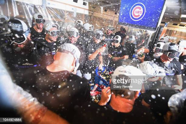 The Colorado Rockies celebrate in the clubhouse after defeating the Chicago Cubs 21 in thirteen innings to win the National League Wild Card Game at...