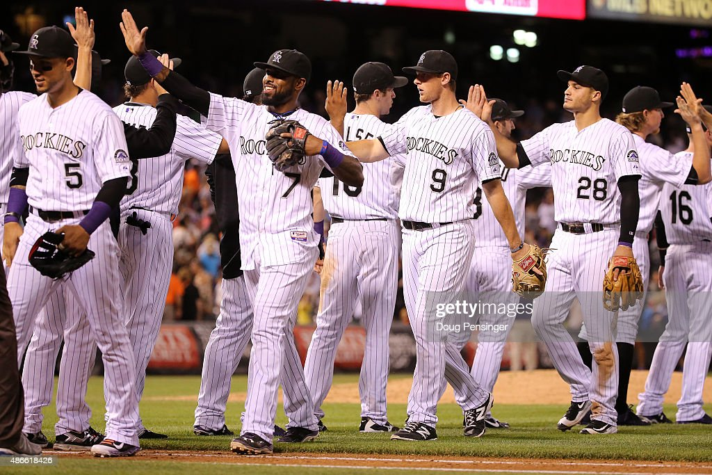 The Colorado Rockies celebrate their 2-1 victory over the San Francisco Giants at Coors Field on September 4, 2015 in Denver, Colorado.