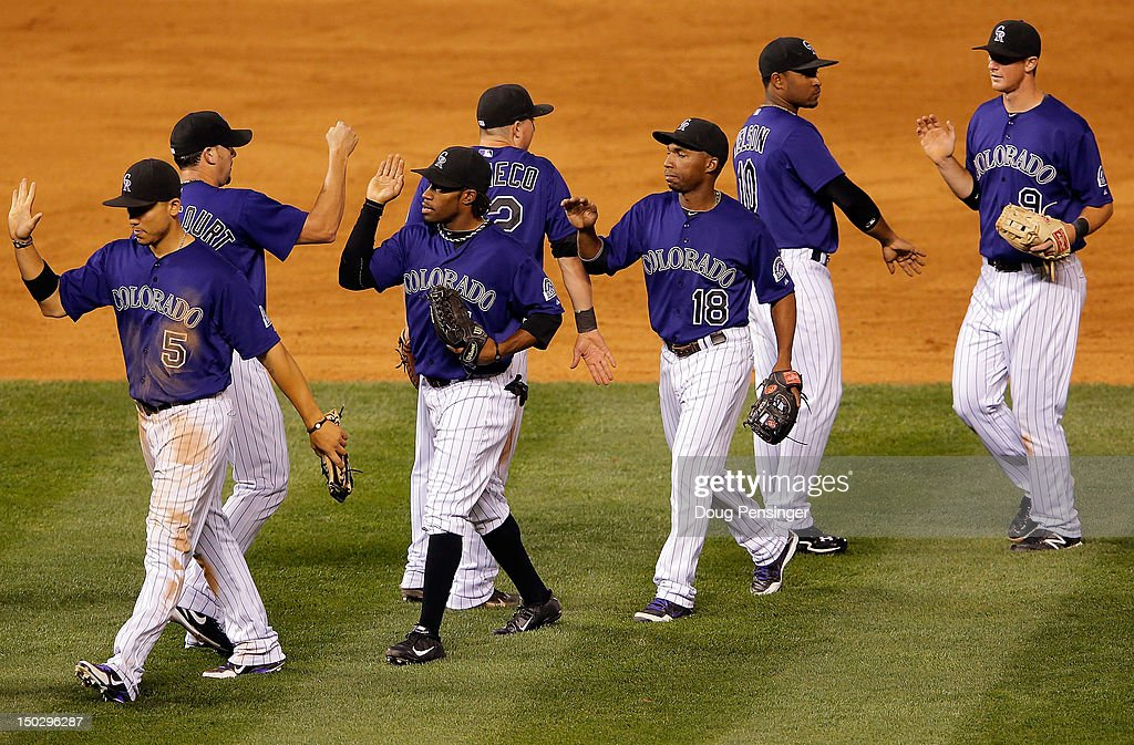 The Colorado Rockies celebrate their 8-6 victory over the Milwaukee Brewers at Coors Field on August 14, 2012 in Denver, Colorado.