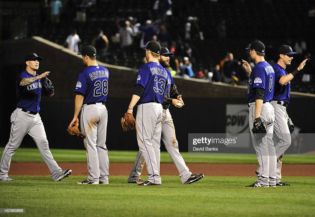 The Colorado Rockies celebrate their win against the Chicago Cubs on July 30, 2014 at Wrigley Field in Chicago, Illinois. The Colorado Rockies defeated the Chicago Cubs 6-4.