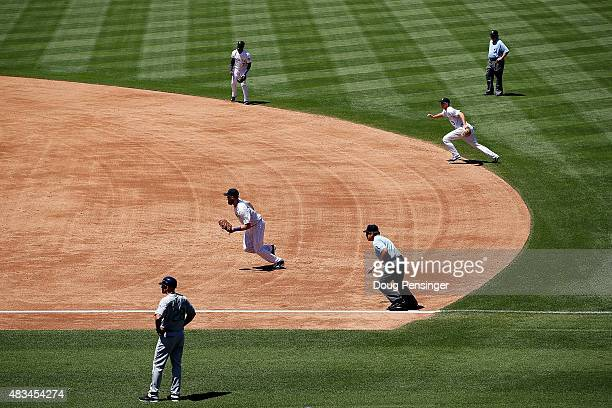 The Colorado Rockies infield employ the infield shift as they defend against the Seattle Mariners during interleague play at Coors Field on August 5...