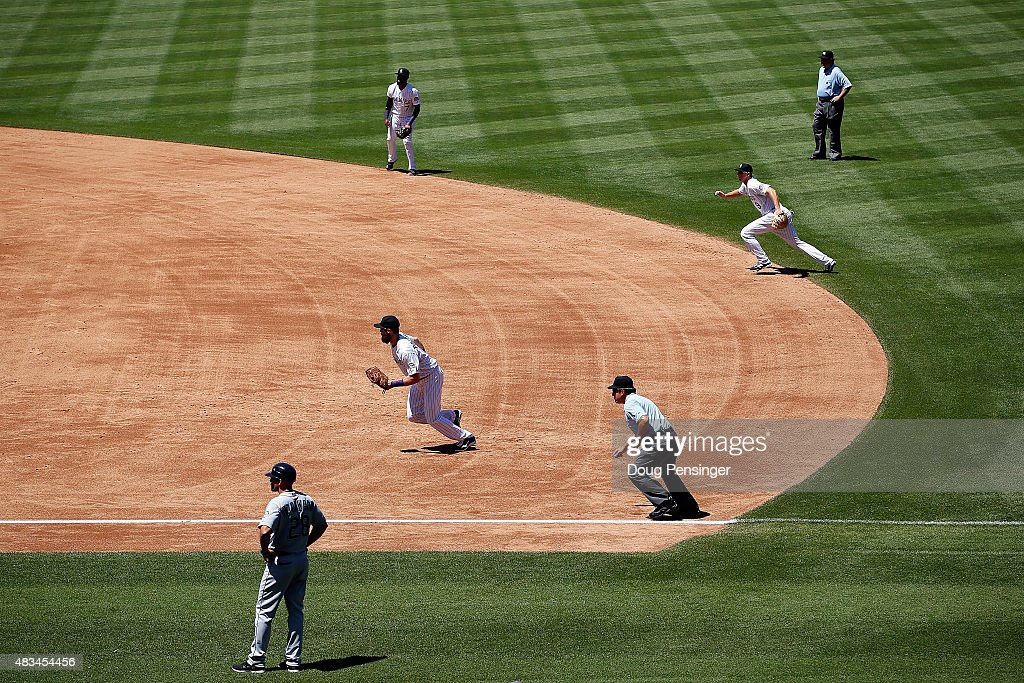 The Colorado Rockies infield employ the infield shift as they defend against the Seattle Mariners during interleague play at Coors Field on August 5, 2015 in Denver, Colorado. The Rockies defeated the Mariners 7-5 in 11 innings.