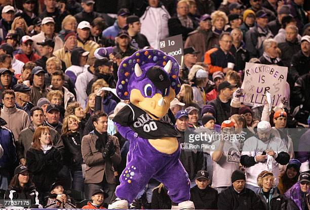 The Colorado Rockies mascot 'Dinger' cheers with fans against the Boston Red Sox during Game Three of the 2007 World Series at Coors Field on October...
