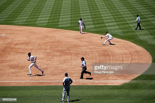The Colorado Rockies successfully employ the infield shift as second baseman DJ LeMahieu of the Colorado Rockies fields a ground ball for a put out...