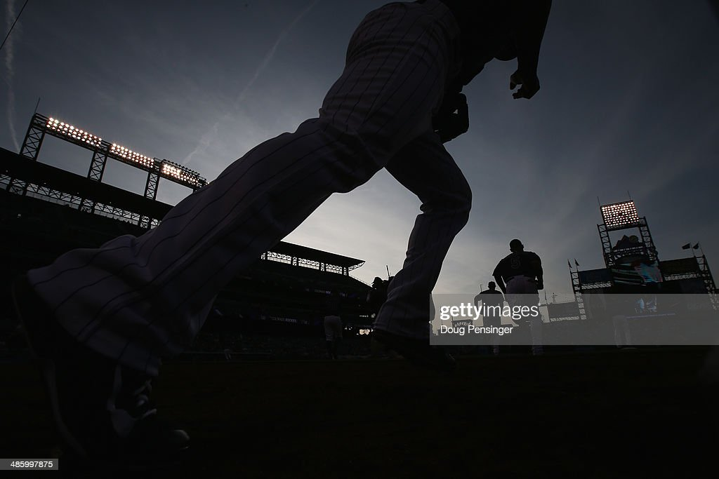 The Colorado Rockies take the field to face the San Francisco Giants at Coors Field on April 21, 2014 in Denver, Colorado. The Rockies defeated the Giants 8-2.