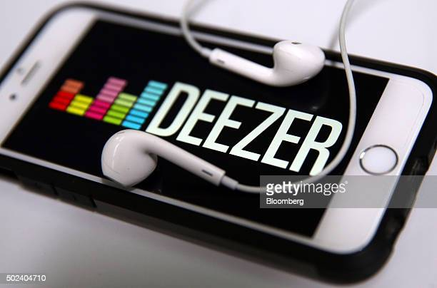 The colored logo for the Deezer SA music streaming service is shown on an Apple Inc iPhone 6s in this arranged photograph in London UK on Wednesday...